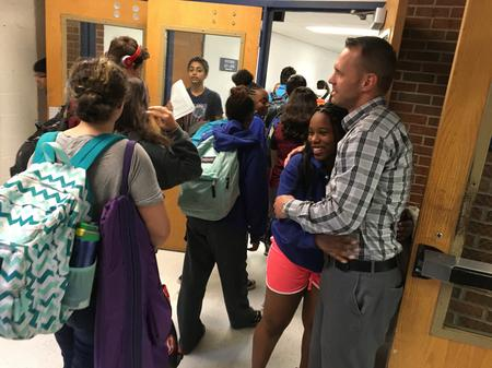 Orchard Lake Middle School Principal Morrison Borders greets students between classesJake Neher/WDET