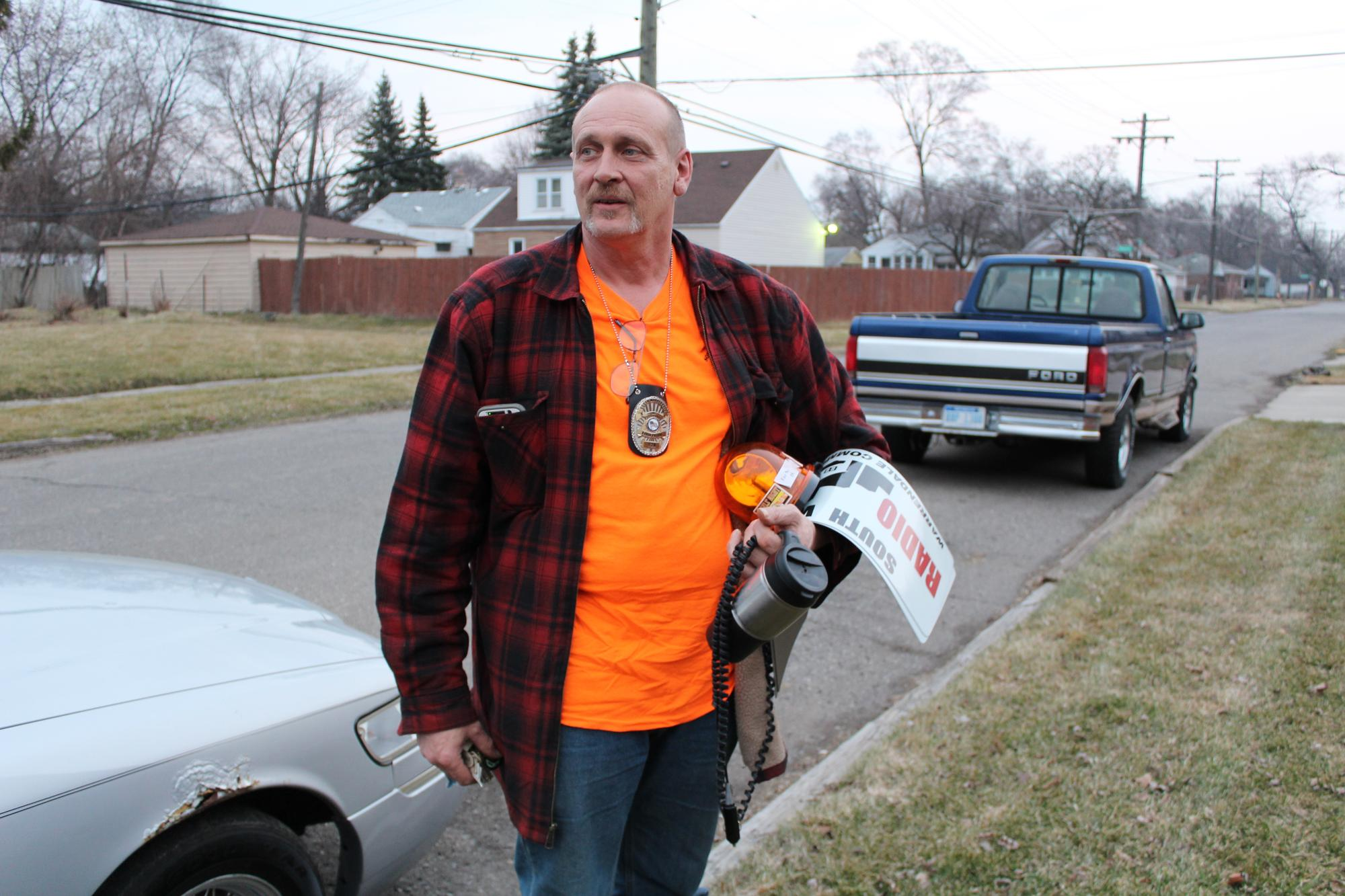 "Barb Matney's husband, South Warrendale Radio Patroller Joe Matney with the gear: the light, the magnetic sign for their vehicle, his official patrol badge, and his beloved coffee. ""I didn't drink the stuff until I became a truck driver,"" Matney says. WDET/Laura Herberg"
