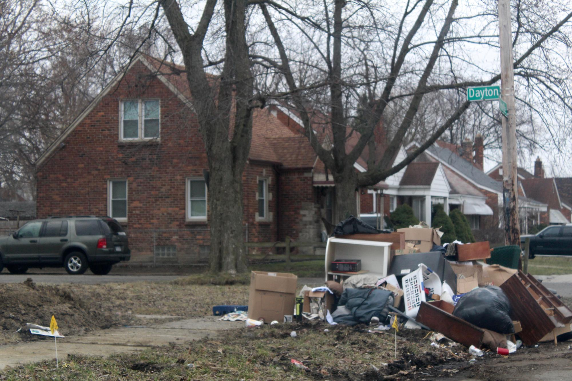 Barb says bulk trash like this is not picked up when it is dumped in front of an abandoned lot. She reports it to the city using the Improve Detroit smart phone app and says it should be picked up within the week.WDET/Laura Herberg