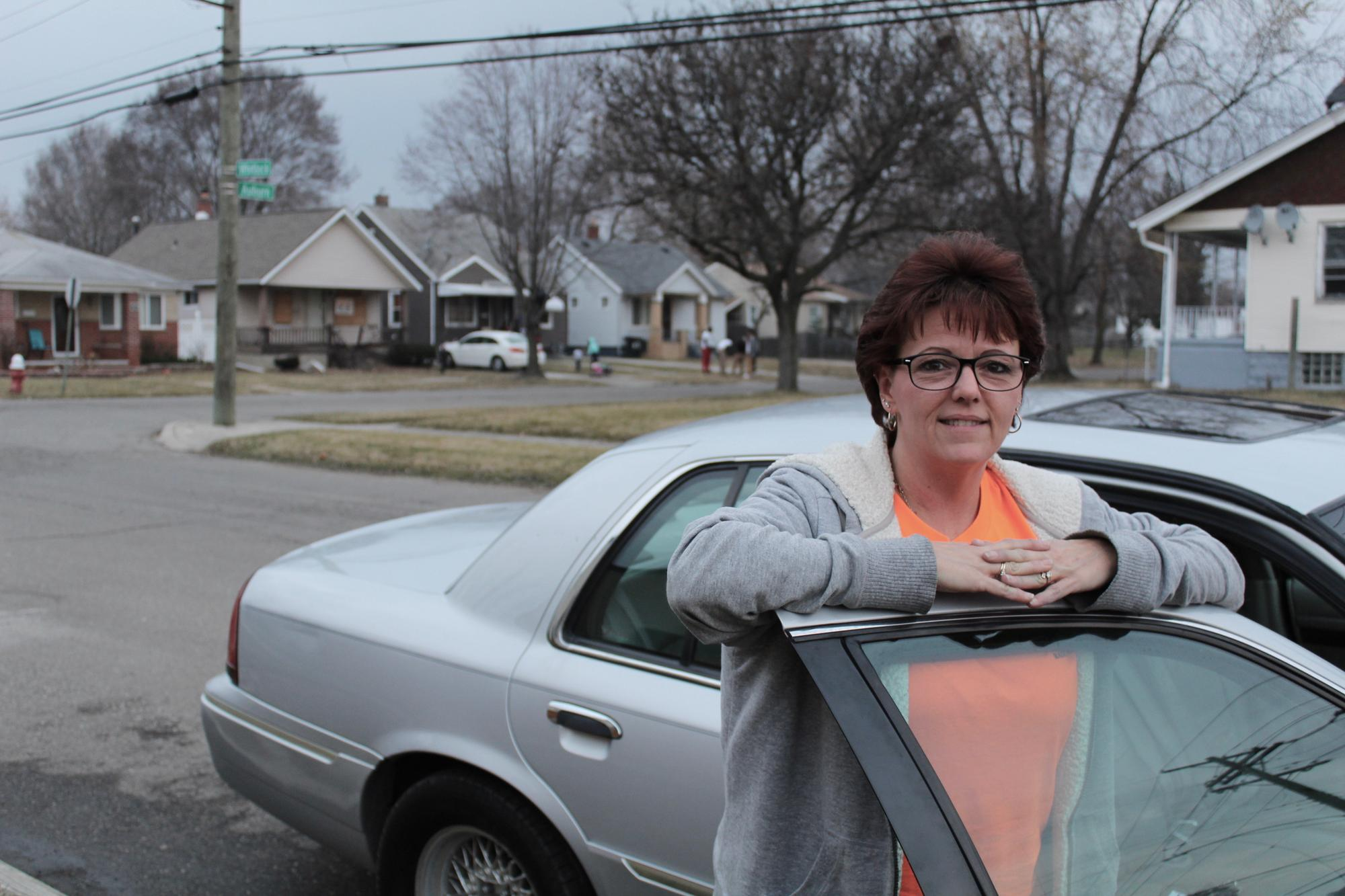 Barb Matney outside the Grand Marquis she patrols her neighborhood in.WDET/Laura Herberg