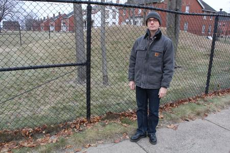 Paul Szewczyk and the mound which stands by the officer's quarters at Historic Fort Wayne in Detroit.WDET/Laura Herberg