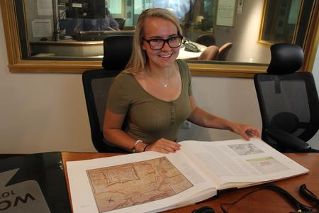 "Listener Bailey Townsend with the book ""Frontier Metropolis: Picturing Early Detroit, 1701-1838""Sandra Svoboda/WDET"