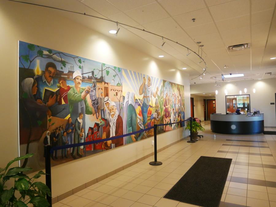 A mural inside the lobby of ACCESS depicts the story of many Arab-Americans making their way to and building community in Detroit.Shelby Jouppi