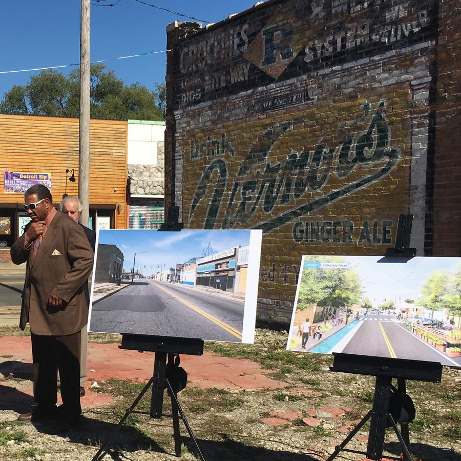 Council Member George Cushingberry Jr. stands next to renderings of a renovated 6 Mile Road. Detroit announced it would sell $125 million city bonds to fund streetscape redevelopment throughout the city.Eli Newman / WDET