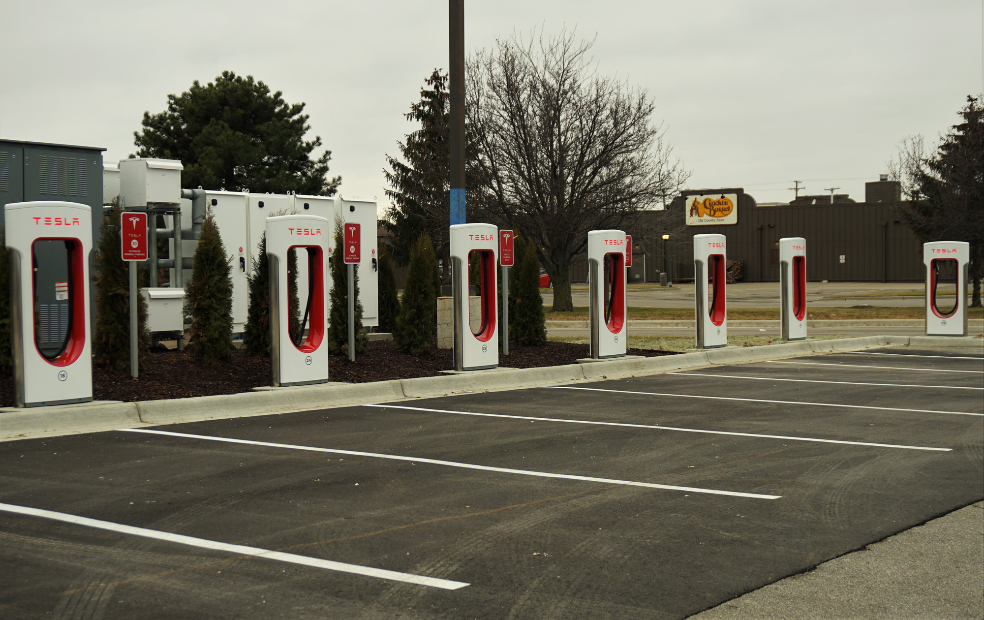 Tesla has placed recharging stations at select locations like this Meijer store parking lot in Roseville, Michigan. Dawn Uhl-Zifilippo/WDET
