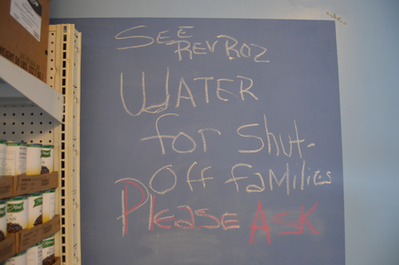 The sign above the Brightmoor Connection Food Pantry's water station.Jake Neher/WDET