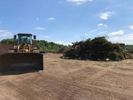 An Advanced Disposal front loader next to a pile of organic waste before its processed.Eli Newman / WDET