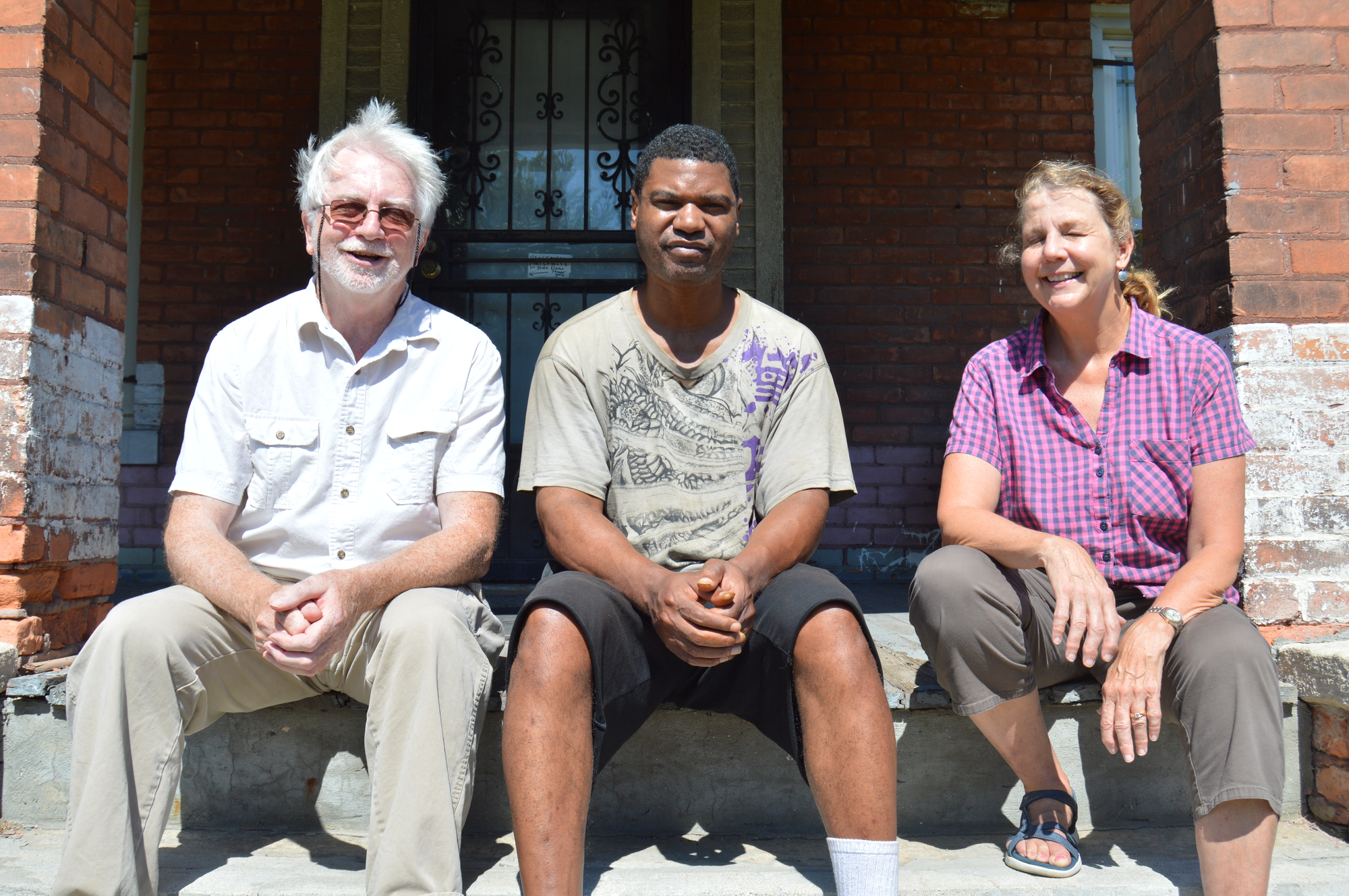 Bill Hall (left) and Kathy Hall Knall (right) with one of the house's current occupants Rodney Harris (middle)Jake Neher/WDET