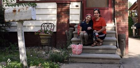 First-time homeowner Myra and her daughter, Rebecca, on the steps of their southwest Detroit home.Global Detroit