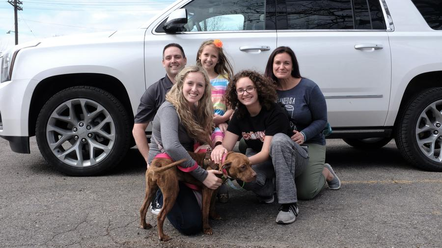 Jenna Martin from New Boston, Michigan (front row, left), pictured with her family, adopted a dog named Boise from the Detroit Animal Care and Control on her 18th birthday.Ryan Patrick Hooper