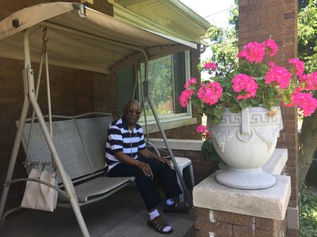 Loretta Lloyd's husband Larry sits on their porch.Laura Herberg/WDET