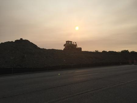 A bulldozer rests atop a pile of dirt on a mound just west of St. Jean.Laura Herberg/WDET