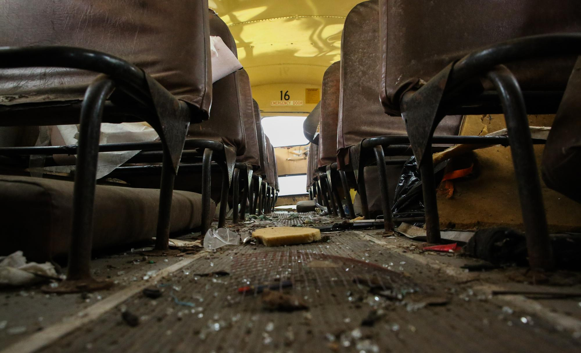 "The glass-strewn floor of one of the vehicles. ""We pick them up at auctions and scrap yards. These buses are on their way to the scrap yard, we just make them last,"" says Franzel.Shiraz Ahmed"