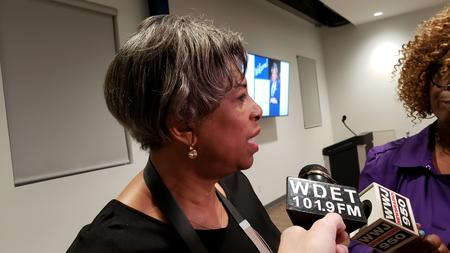 Representative Brenda Jones talks with media at a town hall in her home district.Alex McLenon