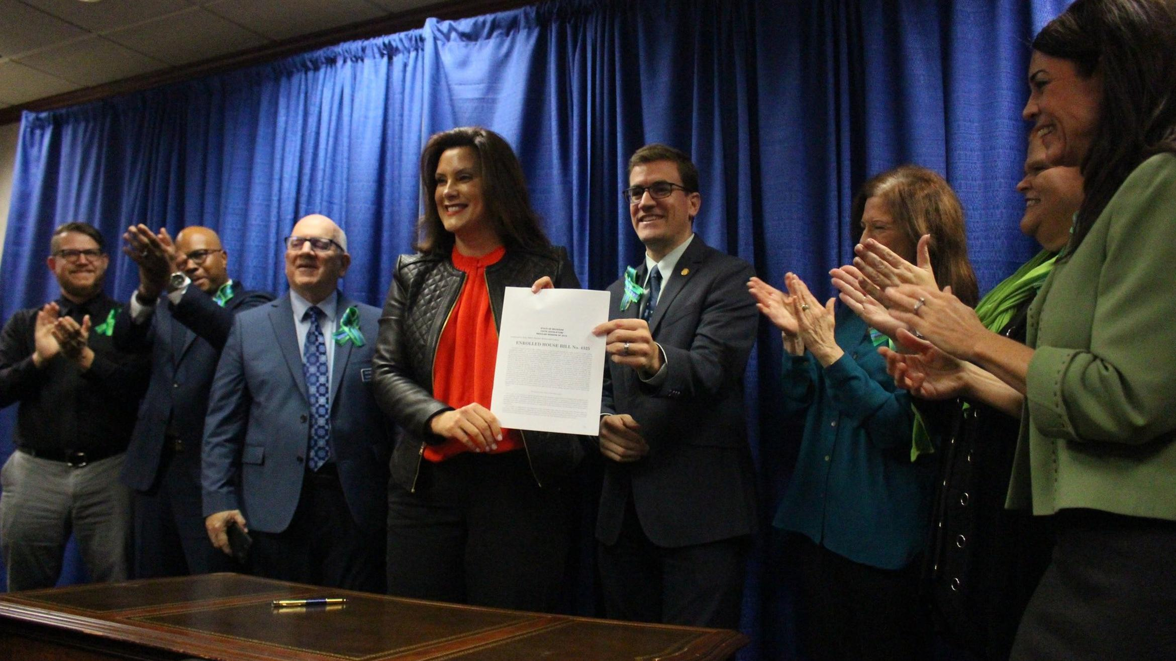 Gov. Whitmer and others holding signed bill, credit: Office of Governor Gretchen Whitmer