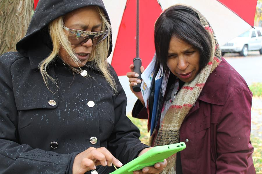 Census Ambassadors Elene Robinson and Rosalind Baker keep track of their canvassing on a tablet.Laura Herberg/WDET