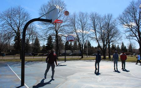 A group of kids play basketball in Detroit during the COVID-19 pandemic.Laura Herberg / WDET