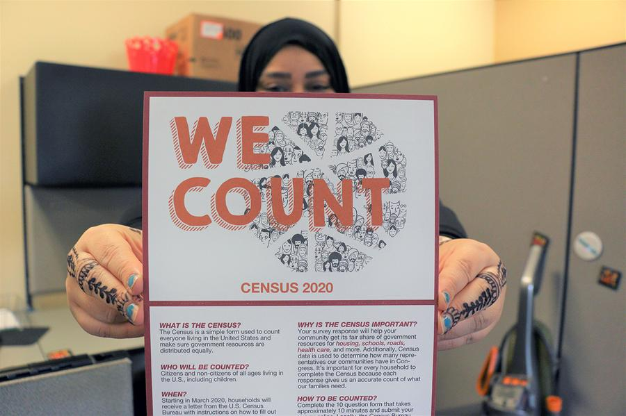 Hanan Khalil holds up a Census pledge card in Dearborn, Mich.David Leins / WDET