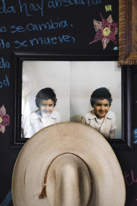 A photograph of my brother, Oscar, when he was young. It's my favorite photograph of my only brother and I placed it above my grandfather's sombrero.Taken by Rosa María Zamarrón for WDET