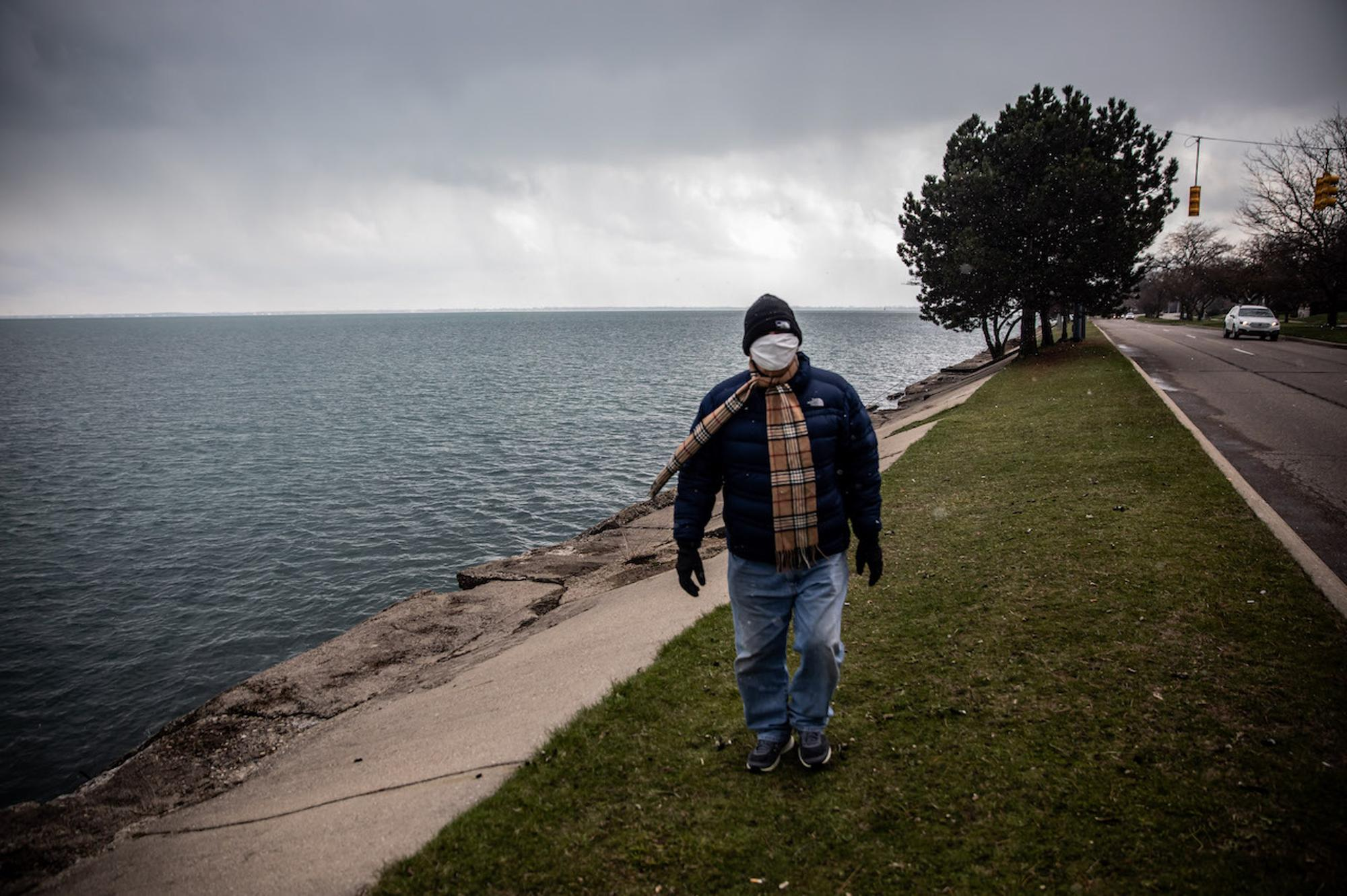 My dad, Tim Sacka, walks along Jefferson Ave. on the shores of Lake St. Clair. Normally, I would meet my parents at their home, but I have not entered their space since the quarantine began.Taken by Amy Sacka for WDET