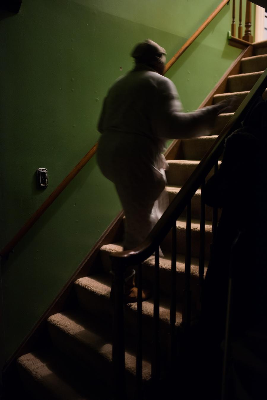 My mother, Michelle Nunn-Thomas walks up the stairs at our home.Taken by Rachel Elise Thomas for WDET