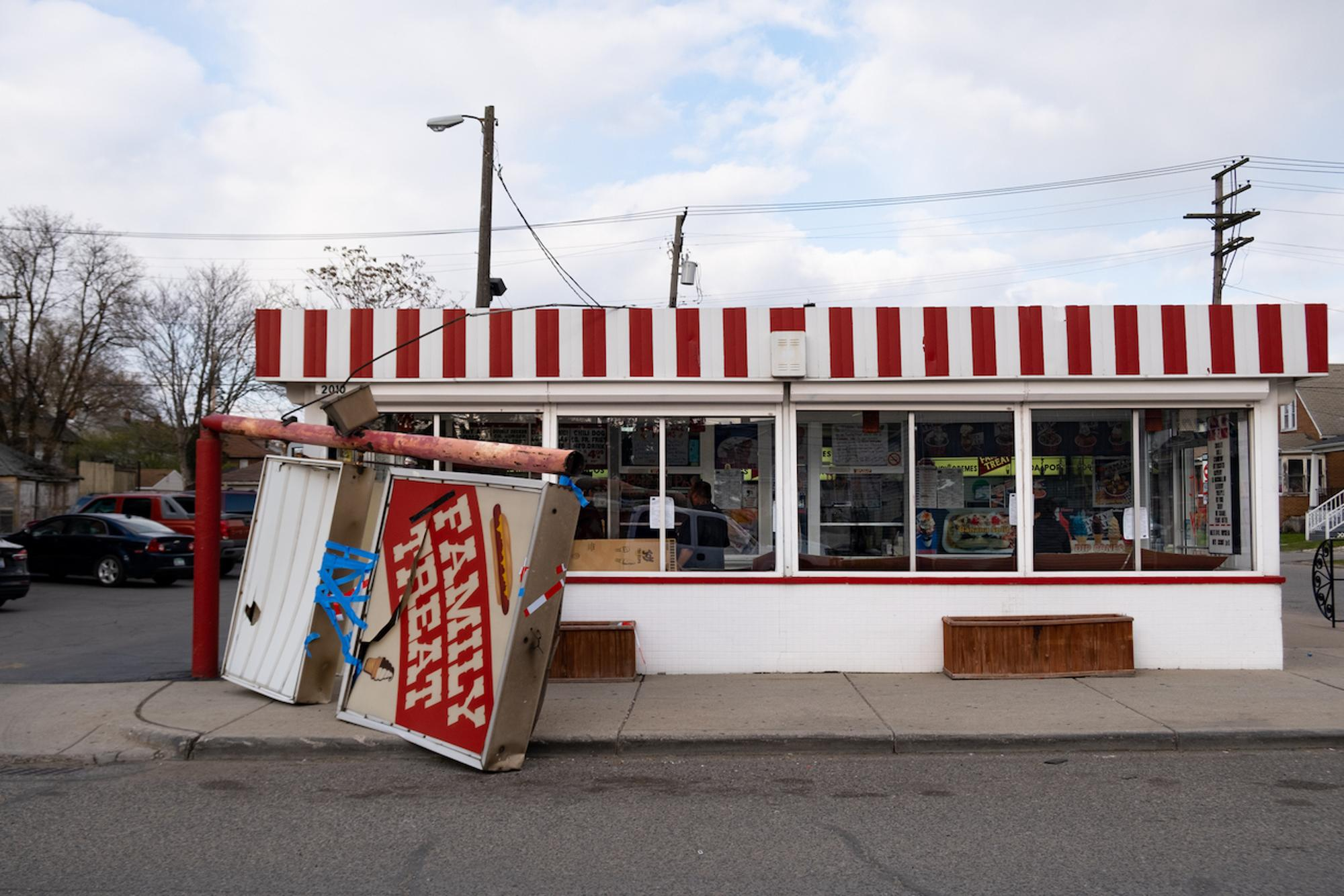 The Family Treat sign was knocked over in high winds during the local favorite ice parlor's annual opening today.Taken by Erik Paul Howard for WDET