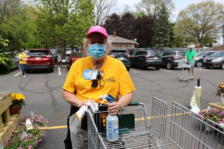 Patricia Toufar greets customers and disinfects shopping carts at English Gardens in Dearborn Heights.David Leins/WDET