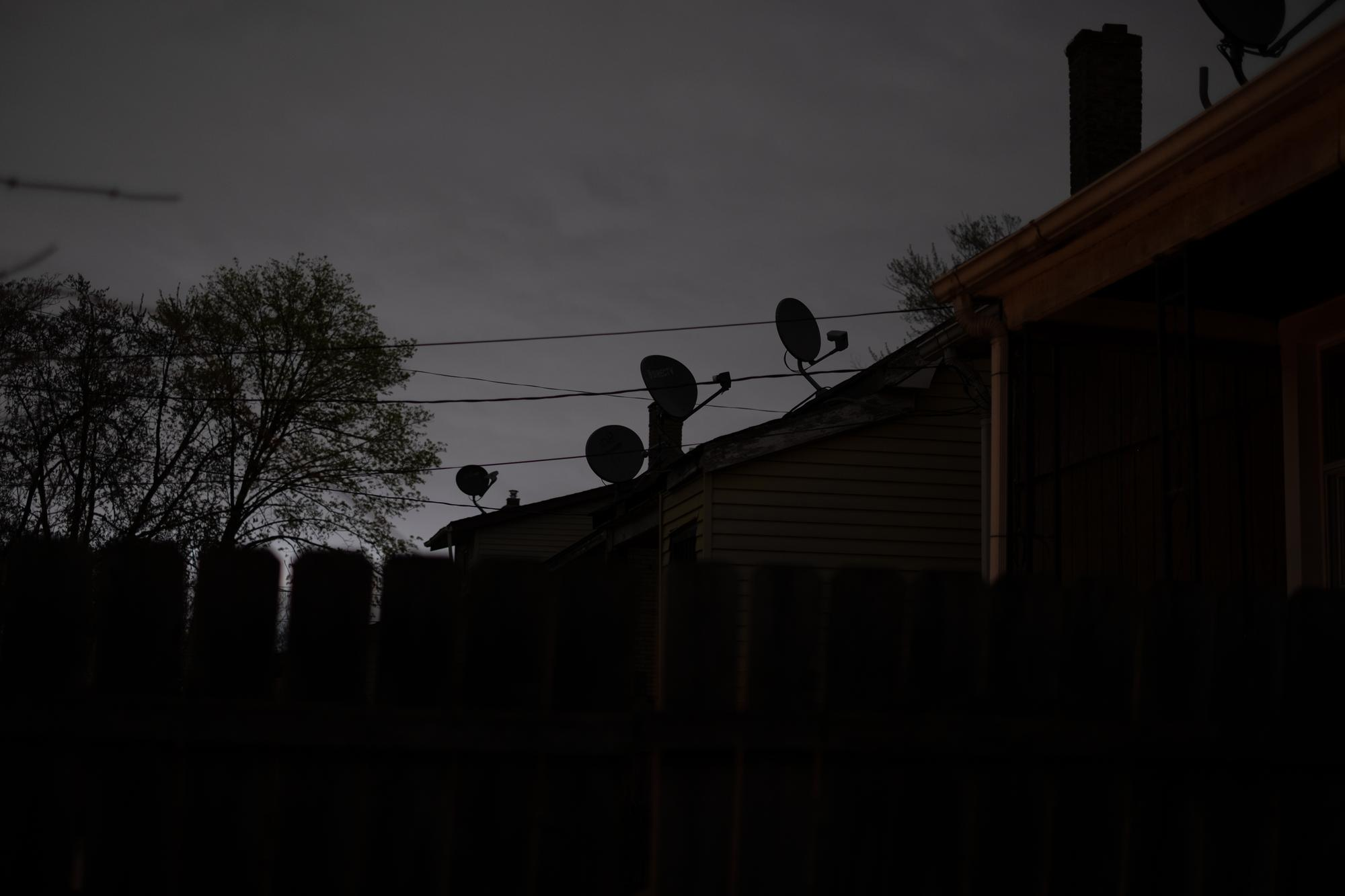 Satellite dishes line the roofs of neighbors' homes in Southwest Detroit.Taken by Erik Paul Howard for WDET