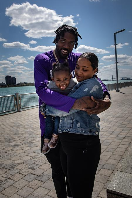 Jalen, Tamra and Milan Reynolds walk a nearly empty river walk in downtown Detroit.Taken by Amy Sacka for WDET