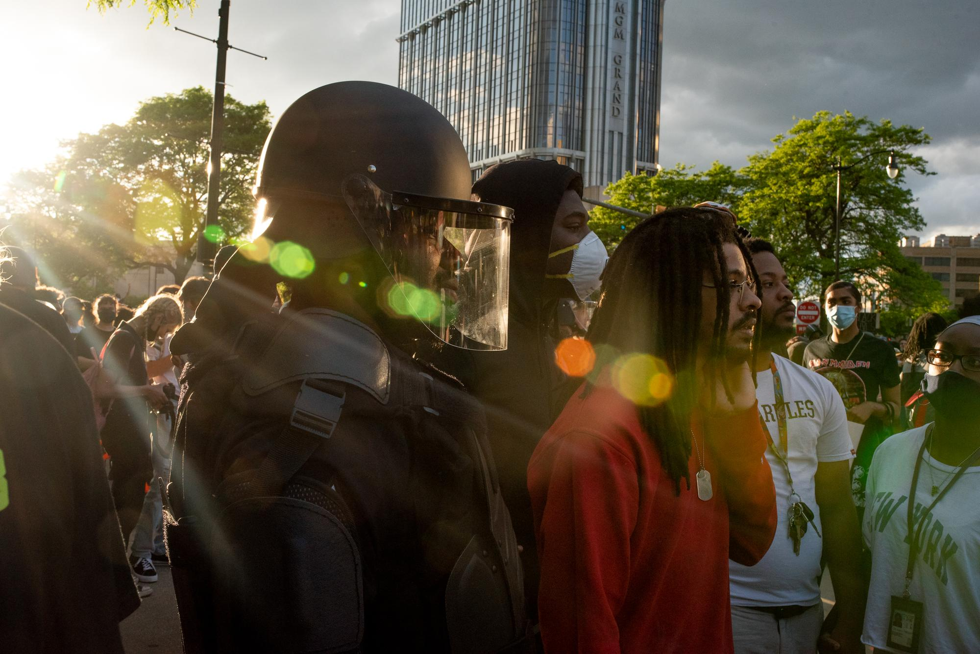 The second day of protesting began and ended at DPD headquarters in Downtown Detroit. Upon arrival, protesters were met with several police officers standing across Michigan Ave. in their riot gear.Taken by Rachel Elise Thomas for WDET
