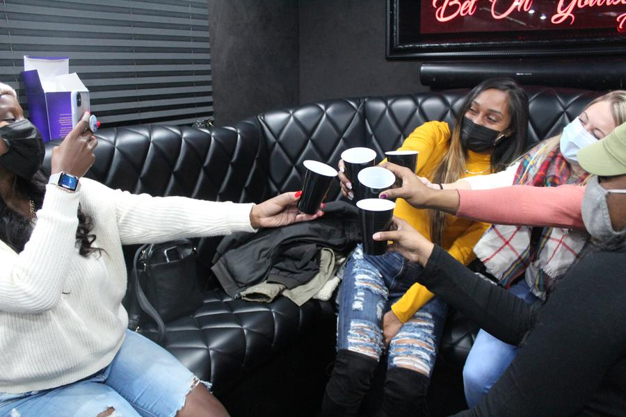 Audrey Vasquez (center) celebrates her 35th birthday with friends inside Luxury Strike's mobile bowling alley.Laura Herberg/WDET