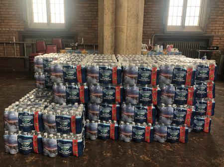 A collection of water bottles ready for distribution at St. Peter's Episcopal Church in CorktownEli Newman / WDET