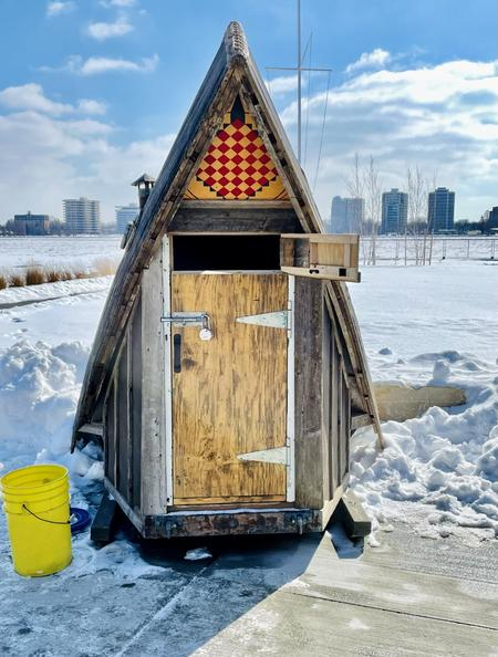 "An ice shanty designed by Scott Hocking and Michael McGillis sits outside the Dossin Great Lakes Museum on Belle Isle, where Amy Sacka's photo exhibit ""Last Ice"" is currently on display through April 24th.Amy Sacka"