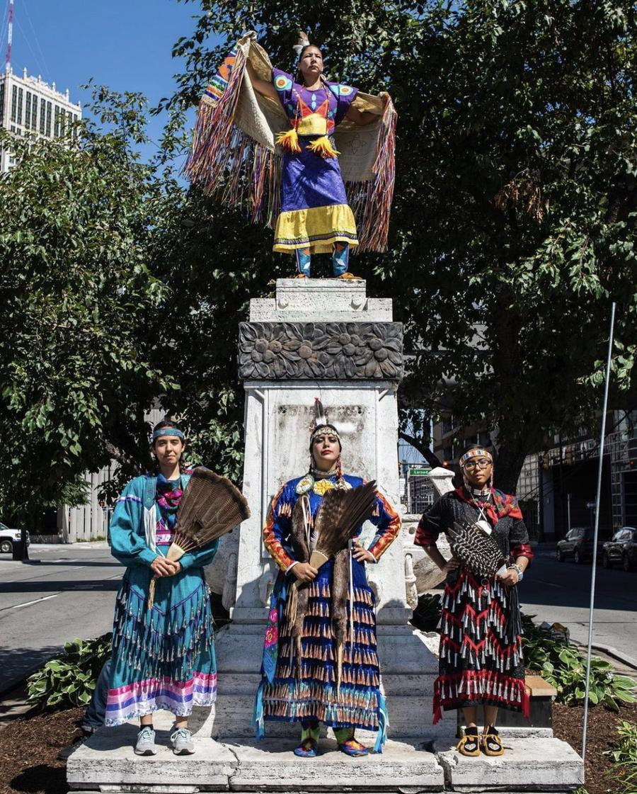 Four Indigenous women stand where a bust of Christopher Columbus once stood.Rosa María Zamarrón
