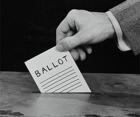 photo of someone casting a ballot